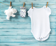 Baby Boy Clothes And White Bea...