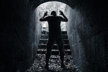 Man Leaves Dark Stone Tunnel W...