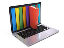 Digital Library And Online Education Concept - Laptop Computer With Colorful Books