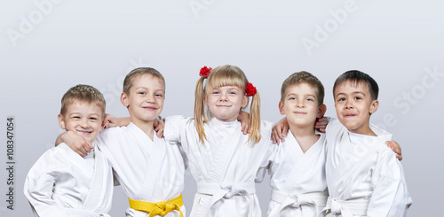 Garden Poster Martial arts Cheerful children in karategi on a gray background