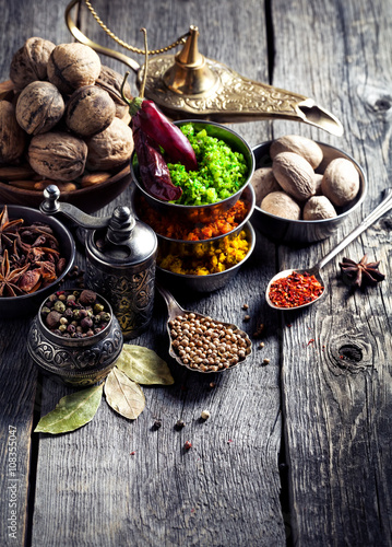 Fotografia  Indian Spices at wooden table