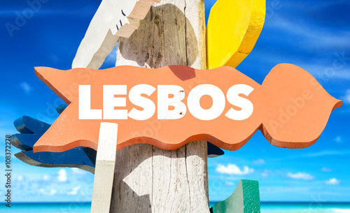 Lesbos signpost with beach background Wallpaper Mural