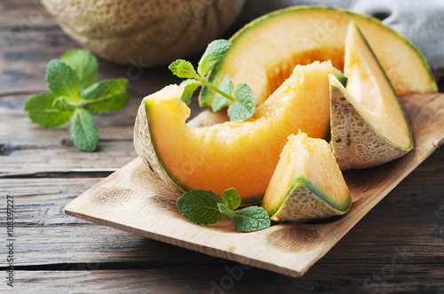 Fresh sweet orange melon and green mint Fototapeta