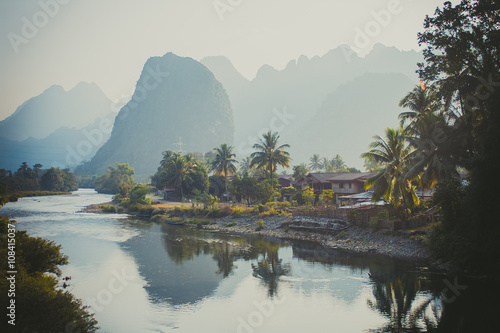 Tuinposter Reflectie Limestone hills reflected in water. Laos, Vang Vieng