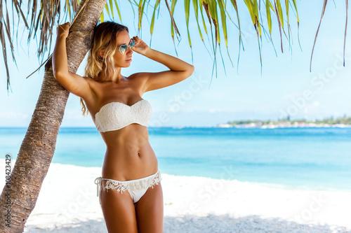 Obraz Woman in bikini posing at beach - fototapety do salonu