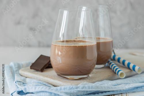 Staande foto Milkshake Chocolate milk in glasses