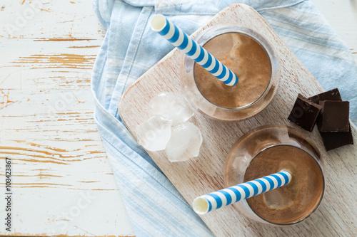 Foto op Plexiglas Milkshake Chocolate milk in glasses