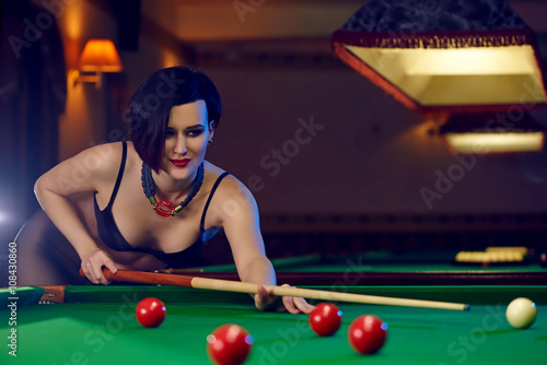 Hot sexy young woman at billiards club playing snooker Fototapet