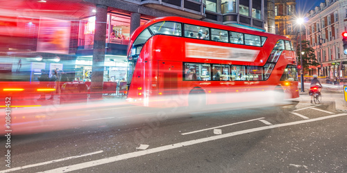 Buses in London with light trails at night