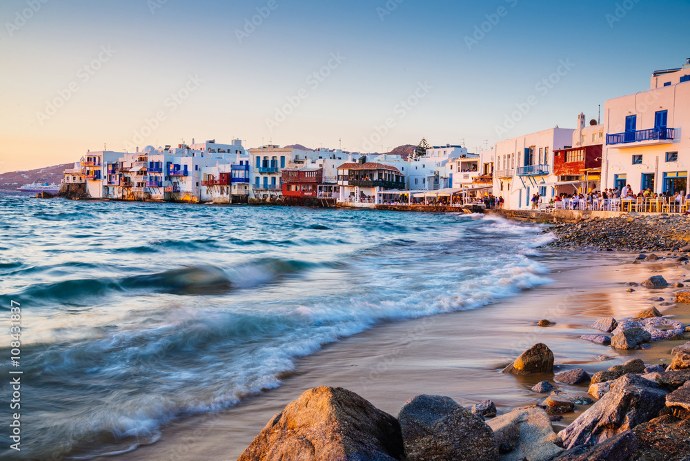 Fototapety, obrazy: Rolling waves and sunset dining at fmaous Mykonos neighborhood of Little Venice, Mykonos, Greece