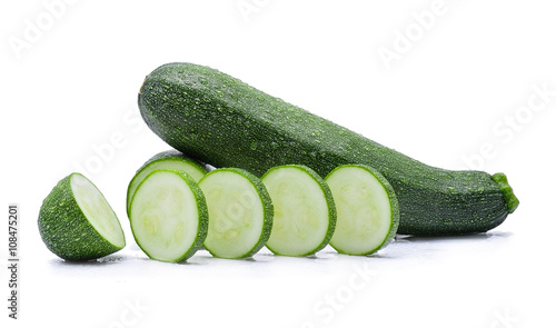 zucchini with water drops on white background