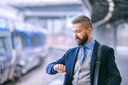 Fotografie, Obraz  Close up, hipster businessman waiting at the train station