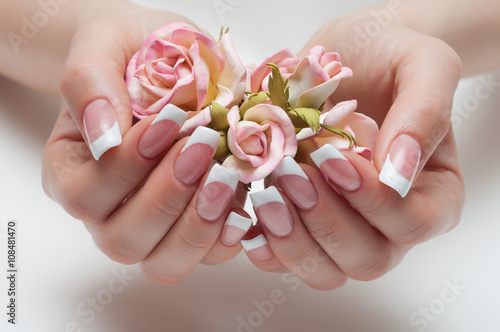 Staande foto Manicure delicate French manicure with a rose in hand