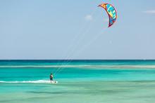 Unknown Kitesurfer Surfing On...