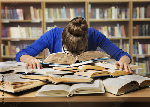 Fotografia  Student Studying Hard Exam, Sleeping on Books Read in Library