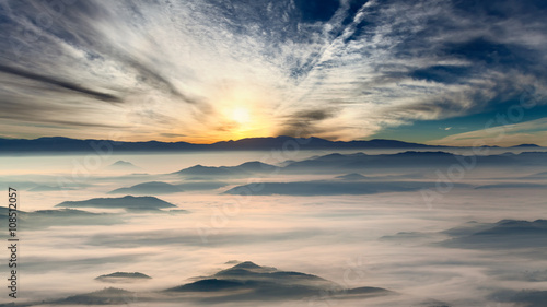 Idyllic mountain landscape at misty dawn
