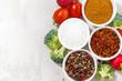 assortment of pepper, salt, spices and fresh vegetables