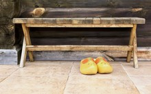 National Traditional Holland Shoes Clogs, Bright Yellow Wooden Clogs, Traditional Holland's Shoes Near Wooden Desk