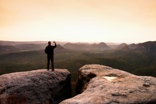 Hiker Photography Sunrise By Smart Phone. Man Stay On Peak Of Rock