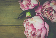 Peony Flowers Vintage. Wooden Background.
