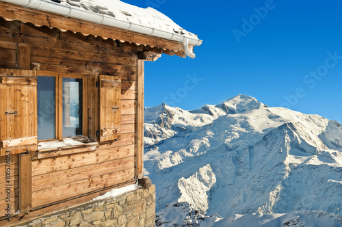 Fotografie, Obraz  winter chalet in french alps mont blanc on blue sky background