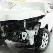 Crushed car in a dealer repair station