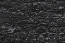 Dark Brown Old Medieval Natural Stone Wall. Texture, Background Or Wallpaper.
