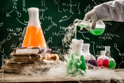 Fotografia  Checking the chemical formula in school laboratory