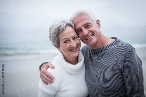 Fotografie, Obraz Happy senior couple embracing on the beach