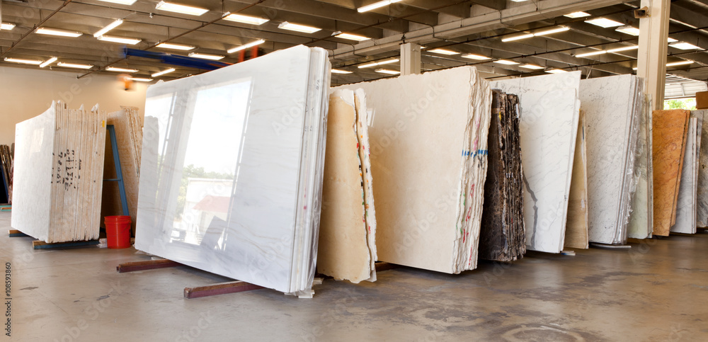 Fototapeta Slabs of granite in a storage warehouse. Construction Material