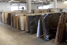 Slabs Of Granite In A Storage Warehouse. Construction Material