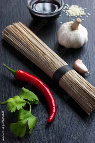 Tela  asian food ingredients on black background