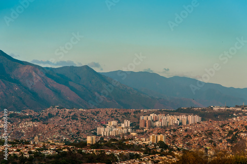 View of caracas slums at sunset with avila in background with clear blue sky