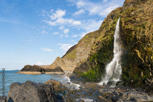 Aluminium Prints Sea Waterfall at Tresaith Beach, Cardigan Bay, Wales.