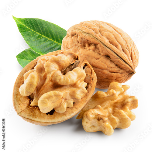 Fotografie, Obraz  Walnuts with leaves isolated on white. With clipping path.