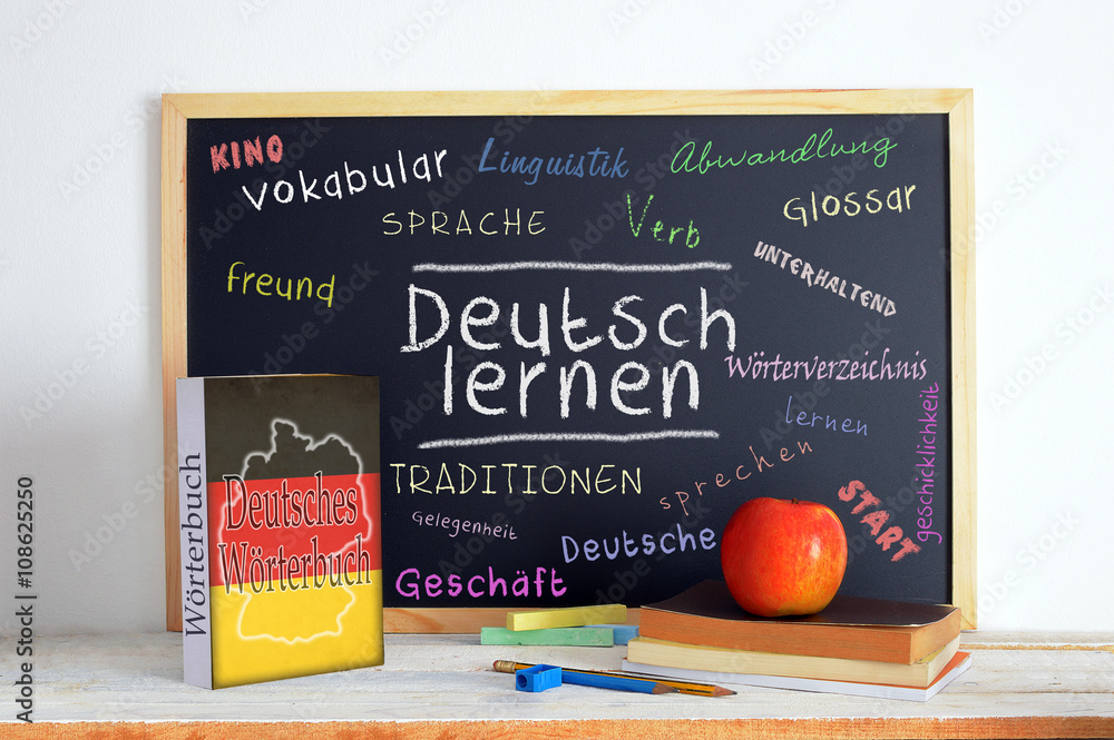 Fototapeta Blackboard in a German classroom with the message LEARN GERMAN and some text
