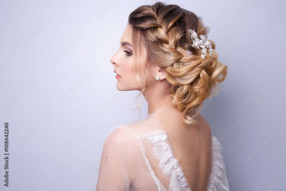 Fototapeta beautiful woman  bride with tiara on head  on bright background , copy space.