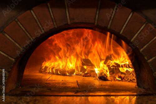 Fototapeta Fire wood burning in the oven obraz