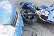 Accident Motorcycle And Cars On  Road