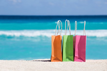 Shopping Bags On Sand Against ...