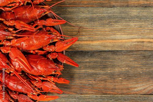 Boiled crawfish on wood background
