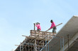 Workers work on a Condominium construction site.They are workwear making reinforcement metal framework for concrete pouring