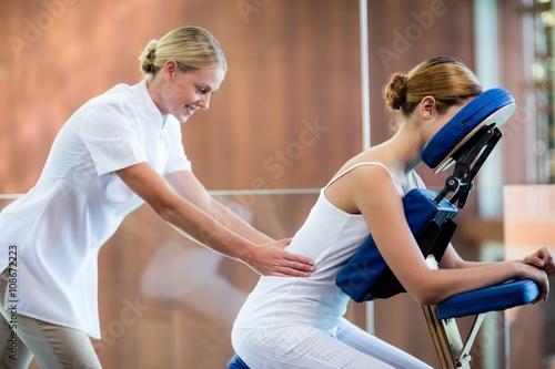 Fotografie, Obraz  Woman receiving massage in massage chair