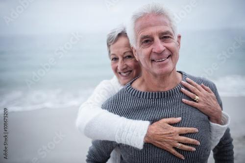 Fototapeta Portrait of happy senior couple embracing each other