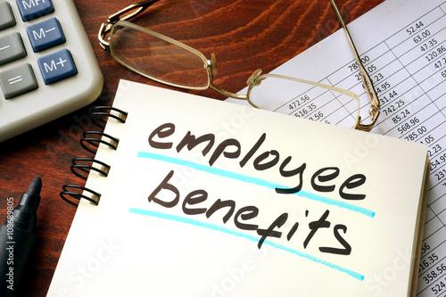 Photo  Employee benefits written on a notepad. Business concept.
