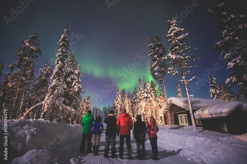 Foto auf Gartenposter Nordlicht Beautiful picture of massive multicoloured green vibrant Aurora Borealis, Aurora Polaris, also know as Northern Lights in the night sky over winter Lapland landscape, Norway, Scandinavia