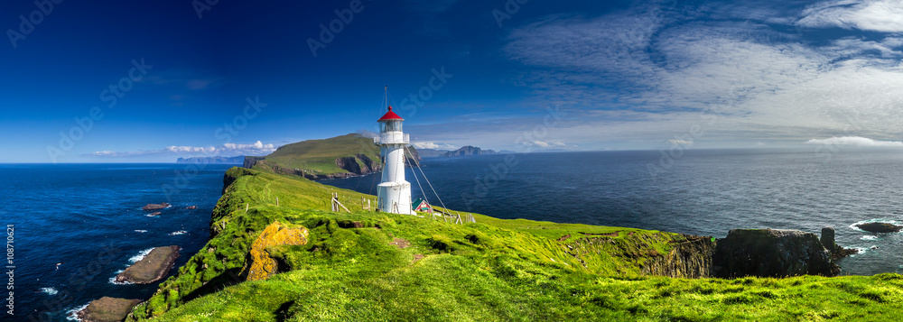 Panoramic view of Old lighthouse on the beautiful island Mykines. - obrazy, fototapety, plakaty