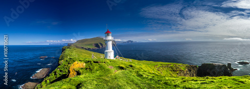 Tuinposter Vuurtoren Panoramic view of Old lighthouse on the beautiful island Mykines.