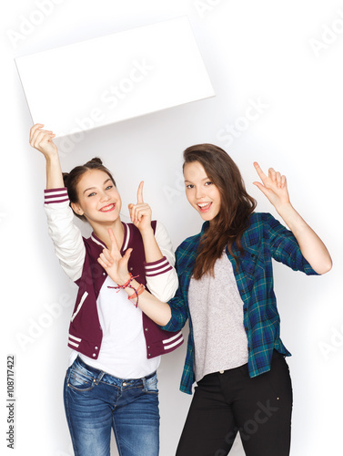 Recess Fitting Artist KB smiling teenage girls holding white blank board
