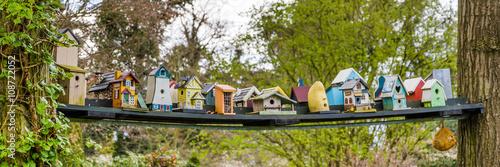 Stampa su Tela Row of colorfull bird houses